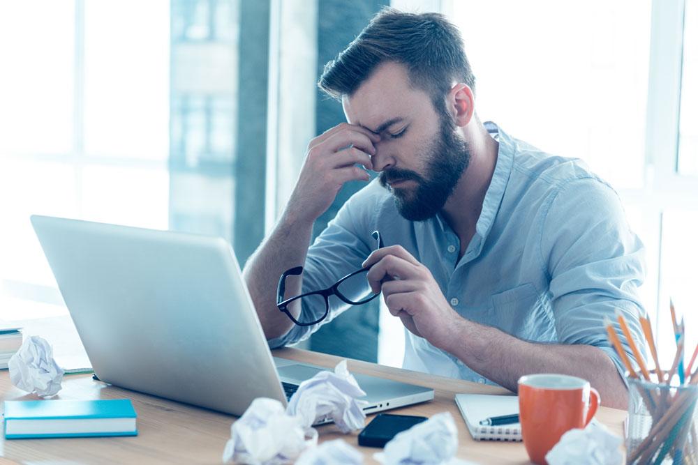 man having trouble staying awake at work