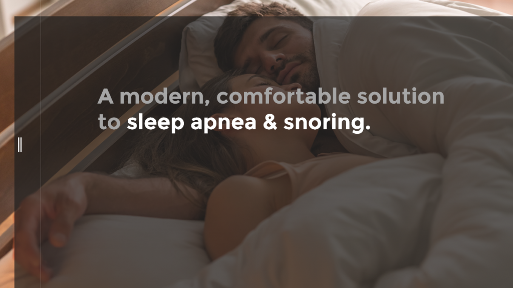 Man and woman sleeping face to face in bed